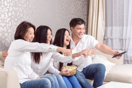family sofa: Emotional moment.  Asian family watching films together at home