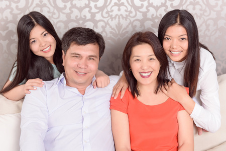 in nice: Important part. Portrait of Asian family at home.