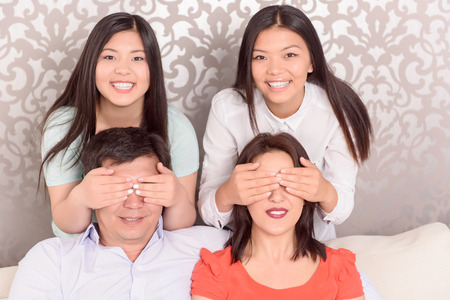 hide and seek: Hide and seek. Family picture of happy Asian family
