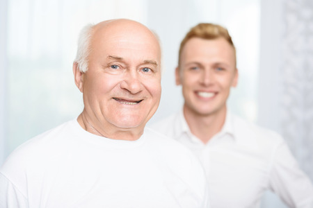 old man standing: Two ages. Old man standing on background of his grandson