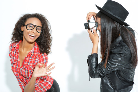 brisk: Real model.  Brisk young girl showing Ok and posing with her friend standing nearby and making snaps.