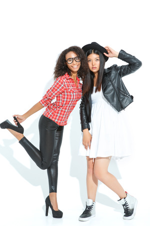 agreeable: Spending time together. Pretty agreeable girls bonding to each other while posing full length.
