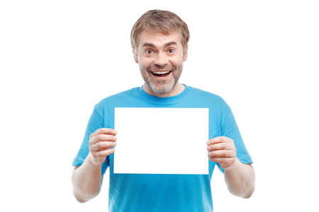 to be pleasant: Be cheerful. Positive pleasant adult man holding paper and smiling while evincing joy.