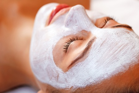 closing time: Time for relaxation. Close up of good looking nice woman having mask and closing her eyes while lying in spa salon