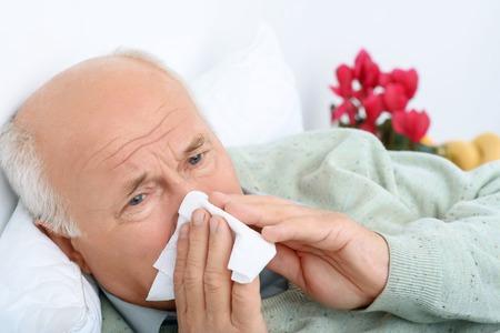 affliction: Looks like its flu. Dispirited old man looks weary and snorts at his handkerchief.