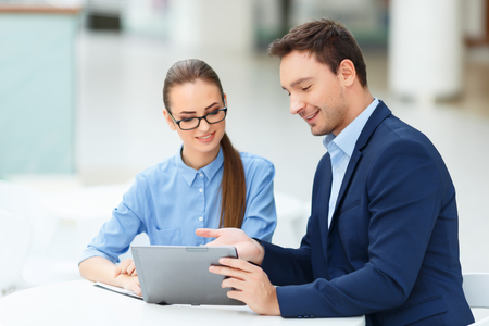 convince: Coworkers intercourse. Radiant male office worker is sharing his ideas and achievements with his female partner. Stock Photo