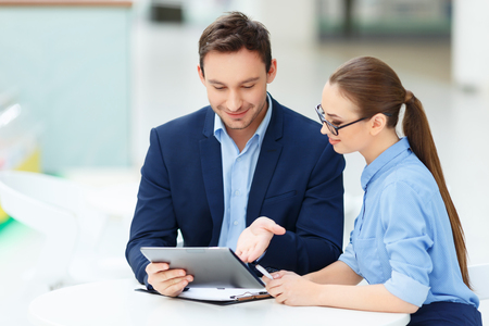 female: Colleagues interaction. Female office member paying attention to ideas of her coworker.