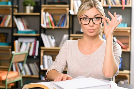 appealing: Nice-looking professional. Young appealing woman is busy with library work.