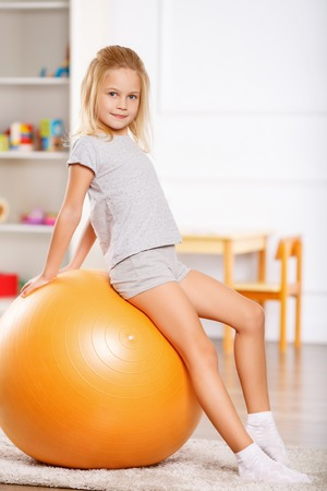 physical training: Little girl is getting ready to do some physical exercises.