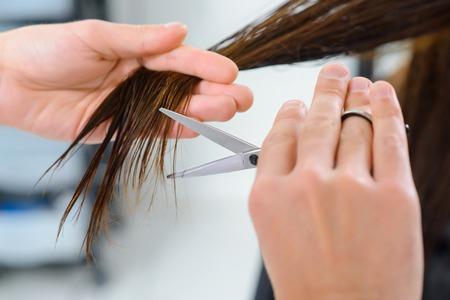 endings: Endings trimming. Close up of hair endings trimming procedure. Stock Photo
