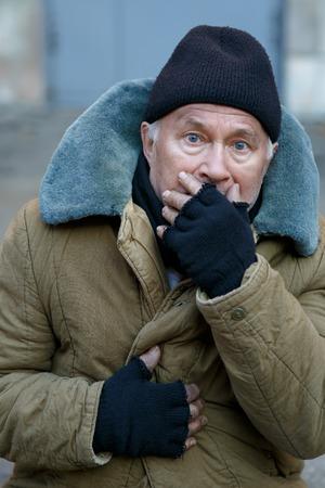 happening: Something happening. Homeless old man seeing something that bothers him.