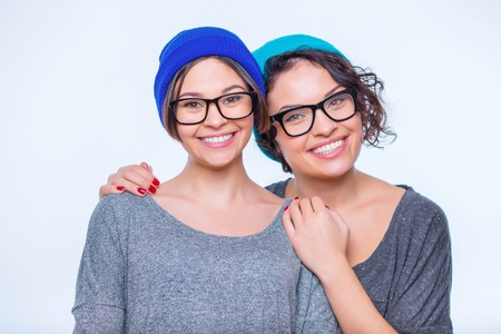 appealing: Sisters hug. Two young appealing sisters are smiling and hugging. Stock Photo