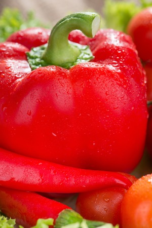 watered: Healthy diet. Close up of red watered pepper lying in a vegetable bowl