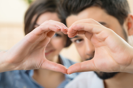 WE are the one. Selective focus of hands of loving coupe forming heart and bonding to each other