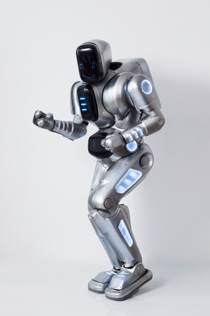 Feel the rhythm. Cheerful positive modern robot smiling and dancing while expressing gladness