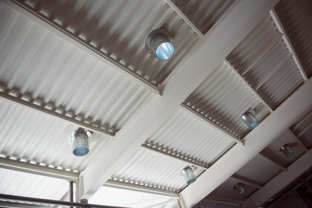 conduction: White ceiling. A modern white ceiling with lamps in a new industrial building may be used as a background