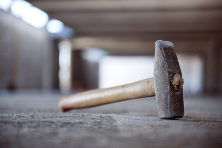 carpenter's bench: Hammer. A usual hammer may be used in construction works, as a background Stock Photo