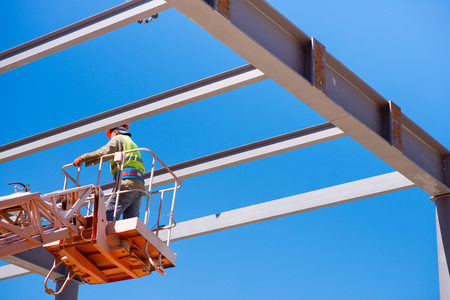 mountings: Moving higher.  A serious worker working being on a crane Stock Photo