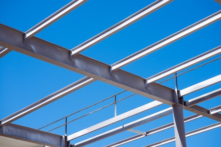 mountings: Metal construction.  A reinforcement being used in construction works standing against blue sky, picture may be used as a background
