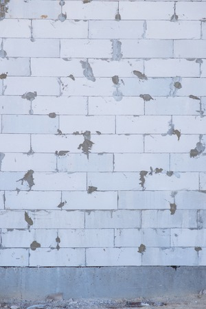 building wall: Brick.  A wall of brick of an undone building, picture may be used as a background