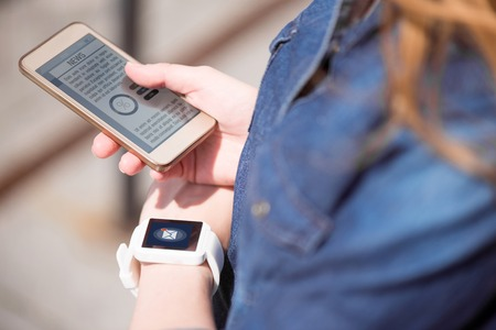 low blouse: Informational world. Close up of a smartphone and a smart watch used by woman