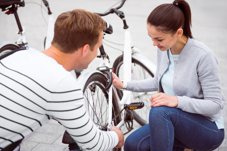 embarrassed: Embarrassed girl looking at the bike and man staring at her with a great interest