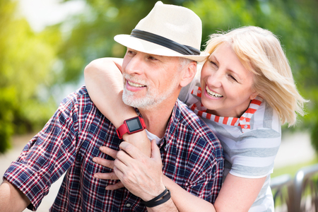 lifelong: Lifelong sweetheart. Happy and content mature couple having fun on a sunny day while being in good spirits