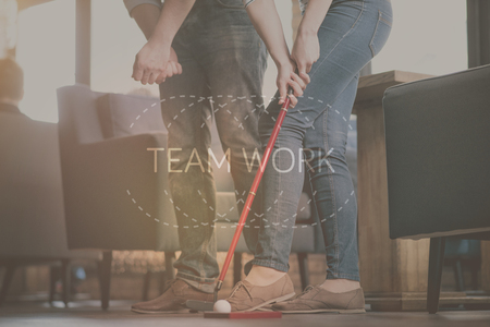Collaborating. Inspirational typographic poster of teamwork with two friends playing golf indoor in a background Stock Photo