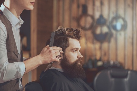 barber scissors: Cool haircut. Cropped image of mens haircut at the barber scissors