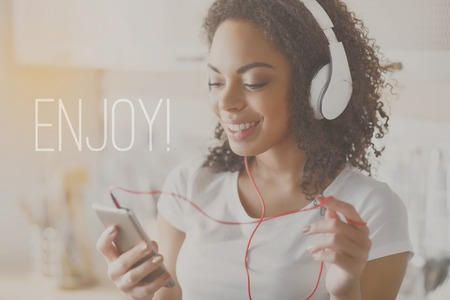 take it easy: Take it easy. Inspiration words on image of young woman listening music background Stock Photo