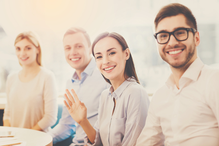 motivated: Teambuilding. A team of motivated and dynamic office workers Stock Photo