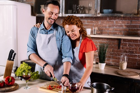Image result for Man helping his wife in the Kitchen
