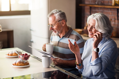 morning routine: Daily life. Happy elderly couple having their regular calm morning routine