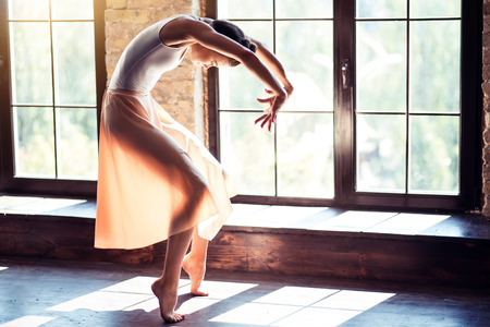 talented: Dance is my life. Young beautiful talented ballerina rehearsing her solo dance while training and spending all her time in a gym.