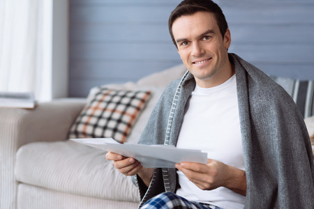 Handsome pleasant man looking at you Stock Photo