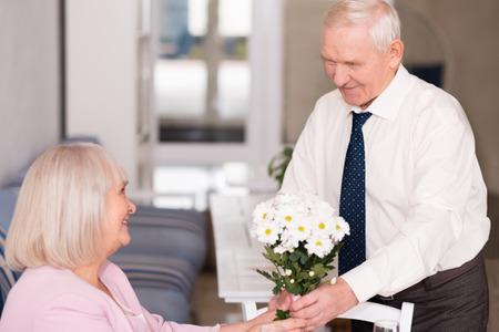 Courteous gentleman holding a bouquet