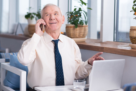 Excited senior executive calling his business partner