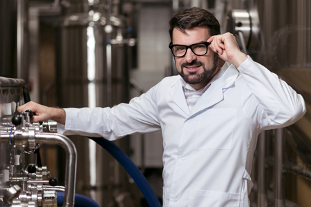 brewery: Joyful man posing in brewery Stock Photo