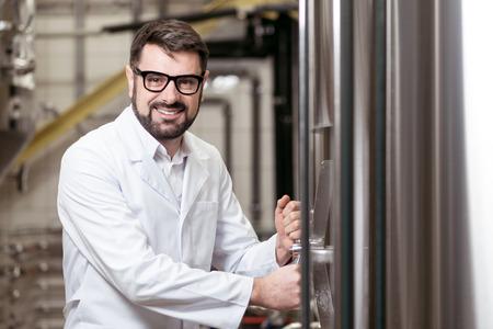 overjoyed: Overjoyed man working on beer factory Stock Photo