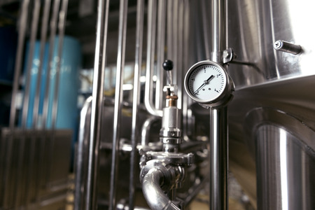 brewery: Measuring gauge being used in brewery