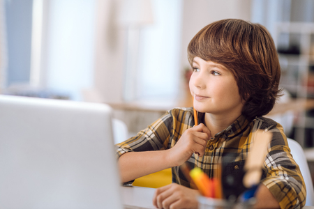 computer lessons: Clever child learning lessons due to computer. Stock Photo