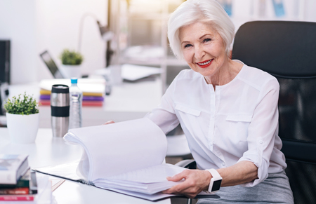 Charming aged business lady working in the office