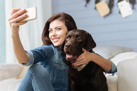 Happy stunning woman using her smartphone Standard-Bild