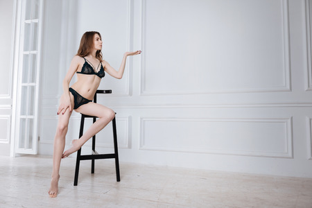 Flexible young girl wearing glamour lingerie