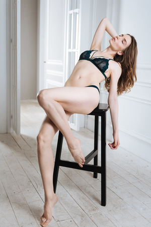 Pretty model posing on the chair