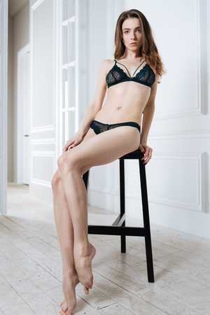 Serious female wearing lace lingerie Stock Photo