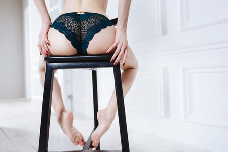 Close up of bouncy booty wearing lace panties