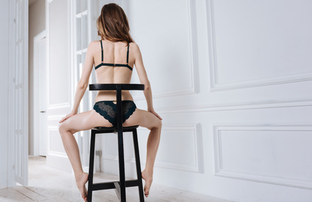 Slim young girl in glamour underwear posing with back Stock Photo