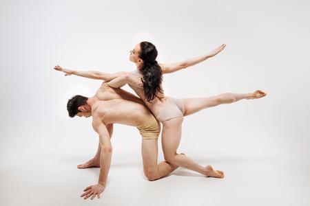 Steady slim ballet dancers posing in the studio