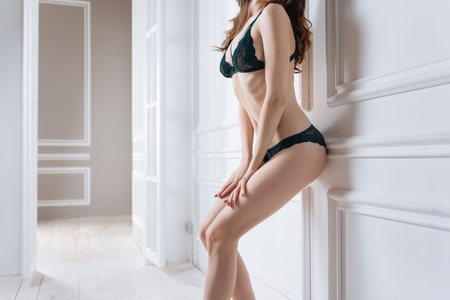 Sporty female posing with hands on legs